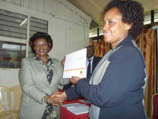 Machakos woman representative candidate Agnes Kavindu receives her nomination certificate from Jubilee Party regional coordinator Susan Maina on May 15, 2017. /ANDREW MBUVA