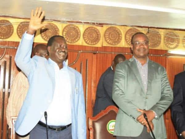 Nasa leader Raila Odinga and Nairobi governor Evans Kidero at Charter Hall during a ODM Nairobi aspirants meeting yesterday./JOSEPH NDUNDA