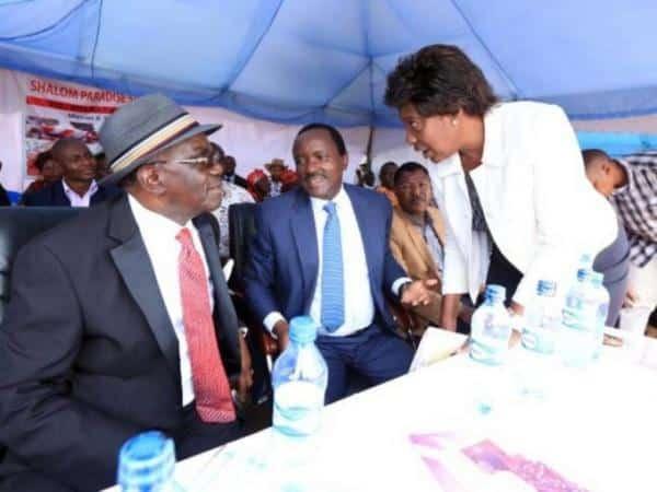 Wiper leader Kalonzo Musyoka with ex-Lands CS Charity Ngilu during the burial of Senator David Musila's mother in Kitui on Saturday, May 20, 2017. /DENNIS KAVISU