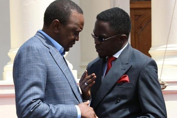 President Uhuru Kenyatta with Budalang'i MP Ababu Namwamba when leaders from western Kenya visited him at State House, Nairobi, on June 22, 2015. Mr Namwamba is also the secretary-general of ODM. PHOTO | PSCU