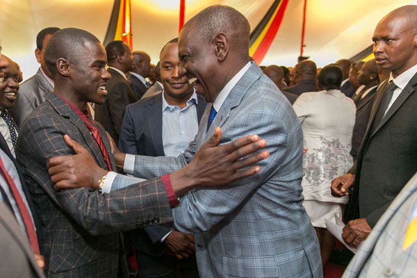 Deputy President William Ruto with Igembe South MP John Paul Mwirigi during the Jubilee parliamentary group meeting at State House, on August 30, 2017. PHOTO | PSCU