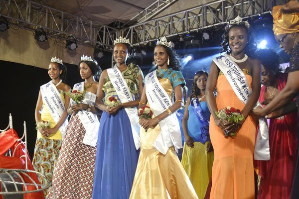 Miss Tourism Finalists who bagged different awards (from left) Miss Tourism Kajiado County Marion Kisoso, Miss Tourism Mombasa County Aisha Habiba, Miss Tourism Narok County Marley Sianto Sikawa and Miss Tourism Marsabit County Qaballe Duba during the crowning ceremony at Mama Ngina Drive, Mombasa on December 20, 2013. PHOTO/KEVIN ODIT